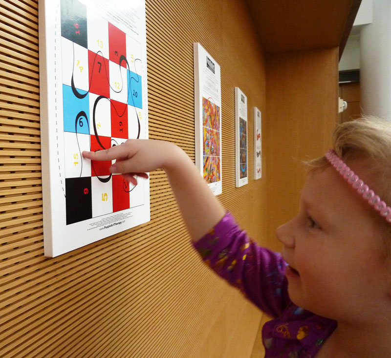 Girl plays with PuzzleArt Skill Builder